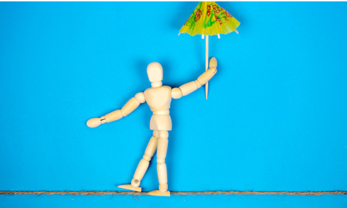 A computer model holding a paper umbrella.